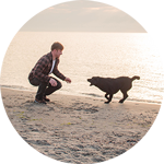 beginningstreatment-alternative-recovery-therapies-article-photo-young-man-having-fun-with-dog-on-the-morning-beach-622963610