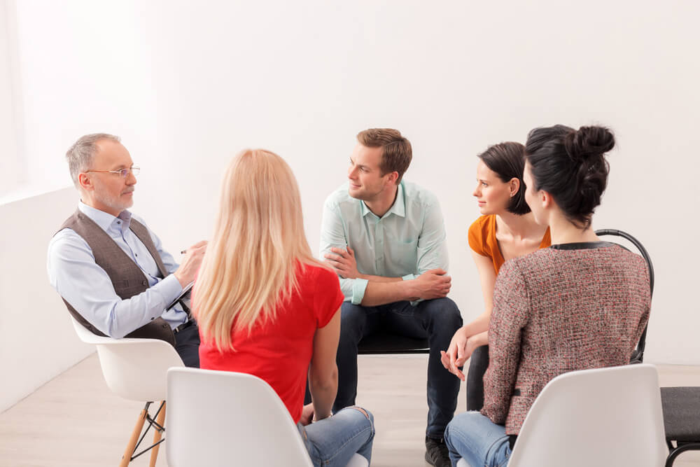 Beginnings Treatment Centers drug addiction treatment addicts in therapy group 427692283