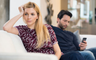 beginnings-treatment-centers-how-to-live-with-an-addict-post-man-and-woman-on-couch-after-argument