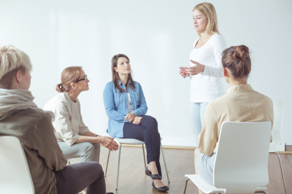 beginnings-treatment-centers-7-factors-that-contribute-to-drug-addiction-article-image-of-women-in-therapy-group