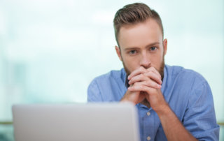 beginnings-treatment-centers-adderall-addiction-and-abuse-article-image-of-stressed-out-man-at-desk-in-front-of-computer