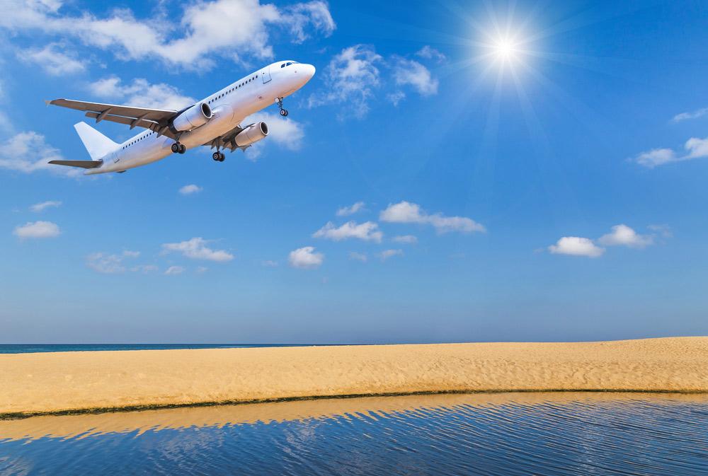 beginnings treatment image of plane landing over beach 541135675