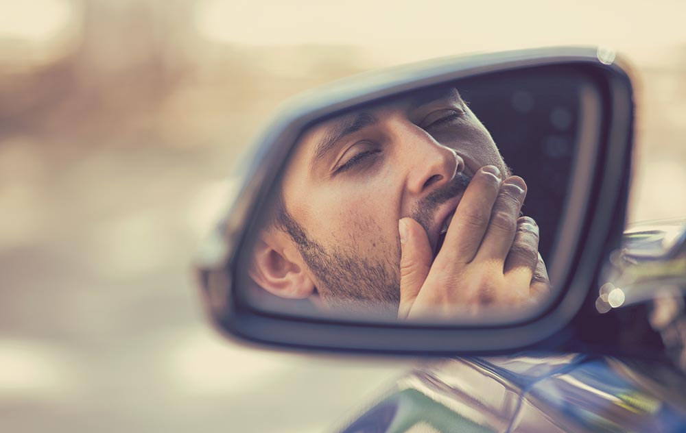 beginningstreatment-medical-marijuana-and-recovery-are-they-mutually-exclusive-article-photo-exhausted-young-man-driving-his-car-in-451805533