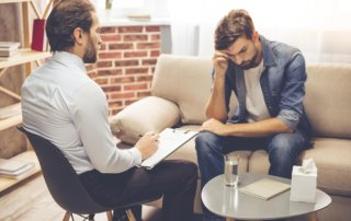 beginningstreatment-should-addiction-counselors-disclose-they-are-in-recovery-article-photo-young-man-talking-to-the-counselor-529084369