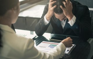 beginningstreatment-the-real-cost-of-addiction-for-employers-article-photo-photo-boss-scolding-a-shameful-employee-at-work-in-an-office-businessman-with-sad-expression-working-521200120