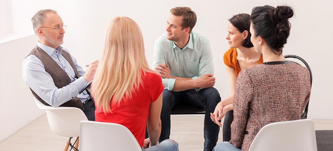 Beginnings-Treatment-Centers-drug-addiction-treatment-addicts-in-therapy-group-427692283