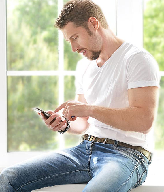 beginningstreatment-night-iop-addiction-treatment-photo-young-man-with-phone-474848428