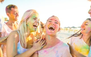 beginningstreatment-7-ways-to-have-summer-fun-without-using-article-photo-happy-friends-group-having-fun-at-beach-party-on-holi-festival-summer-vacation-young-people-666757777
