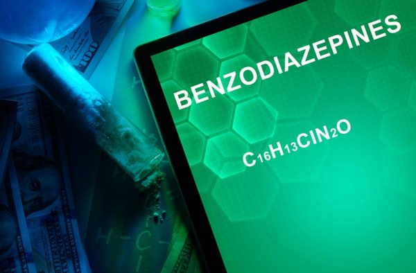 beginningstreatment-benzodiazepine-addiction-the-prescription-drug-that-can-ruin-lives-article-photo-tablet-with-the-chemical-formula-of-benzodiazepines-drugs-and-narcotics-250781602