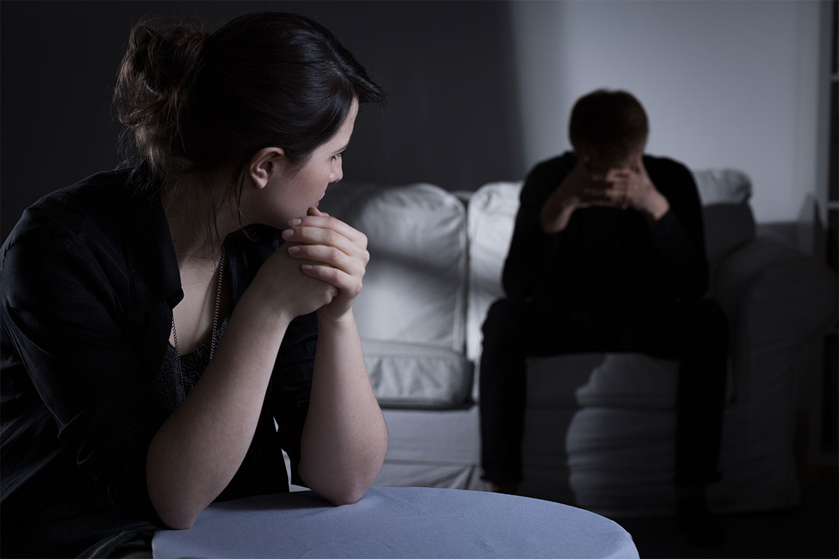 beginningstreatment-substance-abuse-and-divorce-photo-image-of-husband-and-wife-having-marriage-problems-277528928