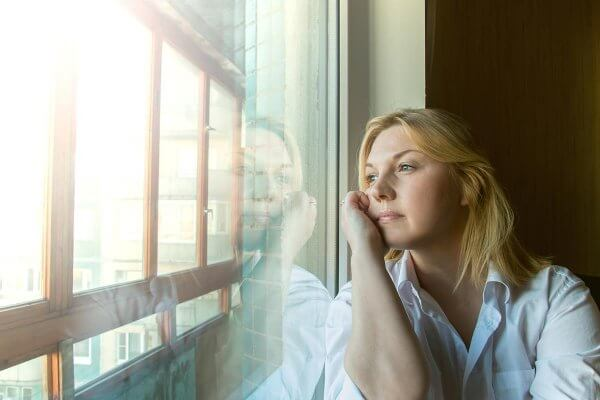 beginningstreatment-emotional-sobriety-do-i-have-it-article-photo-the-woman-lost-in-thought-looking-out-the-window-sunny-morning-288568835