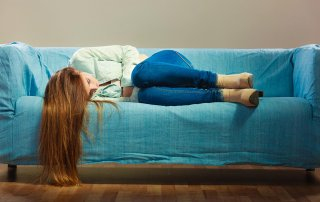 beginningstreatment-heroin-addiction-signs-symptoms-withdrawal-treatment-article-photo-loneliness-negative-emotion-concept-young-sad-stressed-woman-lying-on-couch-at-home-715170220