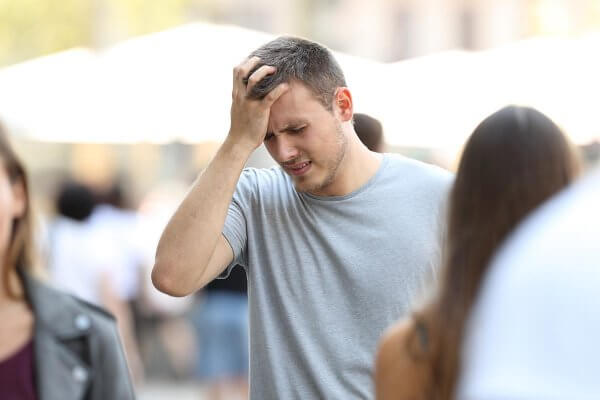 beginningstreatment-what-is-oxycontin-article-photo-of-a-man-suffering-head-ache-walking-on-the-street-695447155
