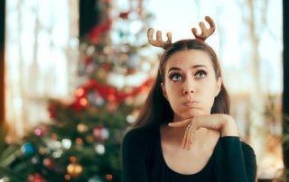beginningstreatment-how-to-maintain-your-sobriety-over-the-holidays-article-photo-sad-bored-woman-having-no-fun-at-christmas-dinner-party-funny-girl-wearing-reindeer-horns-741241924