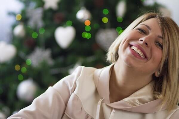 beginningstreatment-im-alone-can-stay-sober-holidays-article-photo-young-woman-celebrating-christmas-alone-730522333