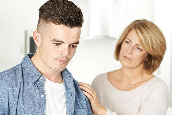 beginningstreatment-how-to-say-no-to-an-addict-you-love-photo-mother-worried-about-unhappy-teenage-son-531839713
