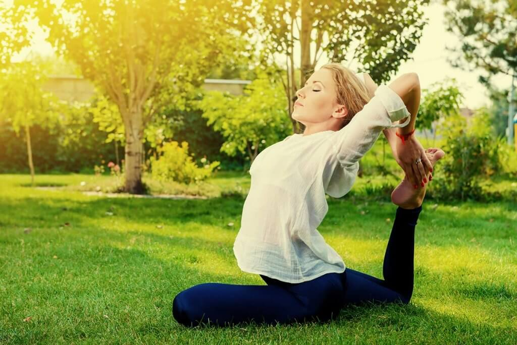 beginningstreatment-holistic-alternatives-to-opioids-for-pain-photo-beautiful-young-woman-doing-yoga-stretching-exercise-in-the-summer-park-healthy-lifestyle-yoga-222399724
