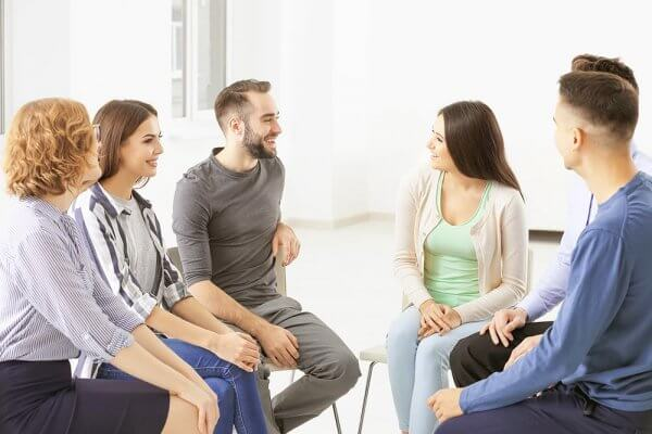 beginningstreatment-detox-photo-people-at-group-psychotherapy-session-indoors
