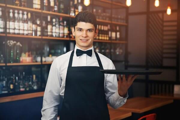 beginningstreatment-how-to-stay-in-recovery-if-you-work-around-alcohol-article-photo-male-waiter-holding-tray-in-cafe