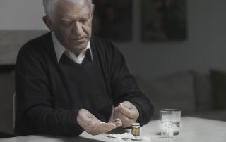 beginningstreatment-opioid-addiction-and-the-elderly-article-photo-senior-sad-man-taking-a-lot-of-medicines