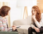woman therapist talks face to face with client as both smile