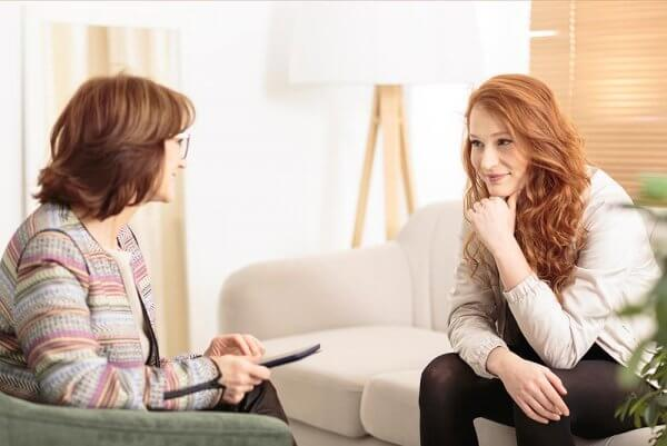 beginningstreatment-how-do-i-find-addiction-treatment-that-works-photo-of-smiling-woman-talking-wellness-coach