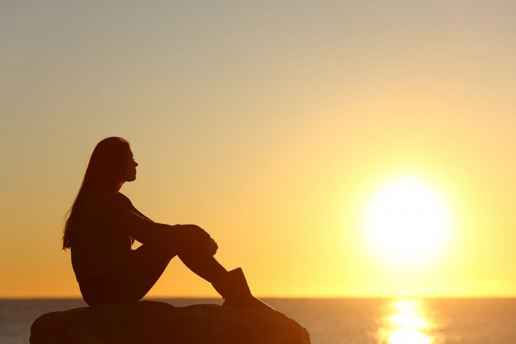beginningstreatment-how-i-found-my-higher-power-woman-silhouette-watching-sun