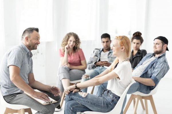 beginningstreatment-heroin-addiction-photo-of-people-in-a-group-therapy