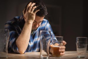 beginningstreatment-facts-about-alcoholism-photo-of-a-man-holding-a-glass-of-beer