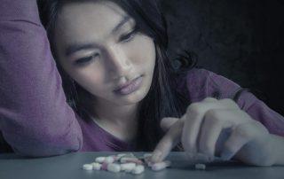 beginningstreatment-what-is-gabapentin-portrait-teenager-girl-choosing-pills
