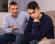 beginningstreatment-How-to-Admit-Addiction-to-Your-Kids-photo-of-a-boy-offended-father-asking-forgiveness