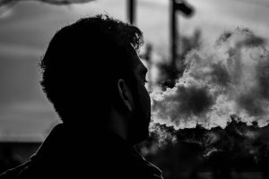 beginningstreatment-the-link-between-vaping-and-drug-addiction-photo-of-backlight-backlit-black-and-white