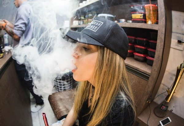 beginningstreatment-the-link-between-vaping-and-drug-addiction-photo-of-young-adult-lady-blur-cap-vaping