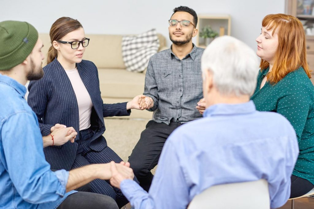 beginningstreatment-How to Get the Courage to Share at a 12 Step Meeting photo of a group-therapy-session