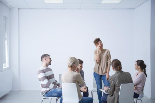 beginningstreatment-psychodrama-in-addiction-treatment-photo-of-a-group-young-people-laughing-together-during-psychotherapy