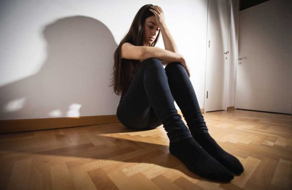 beginningstreatment-7-warning-signs-of-alcoholism-photo-of-depressed-woman-sitting-on-floor